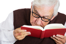 Old Man In Glasses Having Difficulties To Read A Book