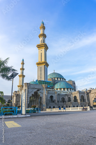 Wilayah mosque with bluew skies background Poster