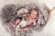 canvas print picture - Baby liegt auf Lammfell