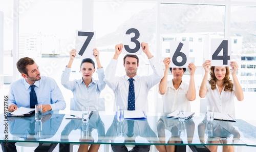 Obraz na płótnie Group of panel judges holding score signs