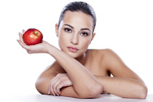 Portrait Of A Beautiful Girl With An Apple In Her Hand