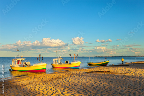Fishing boats in Sopot with port in the background, Poland.