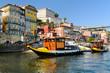 canvas print picture Boats on the Douro river in Porto, Portugal