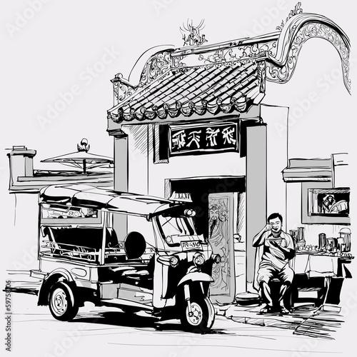Photo  Tuk tuk driver eating at the door of a chinese temple in Bangkok