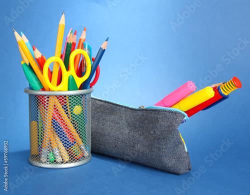 pencil box with school equipment on blue background Fototapeta