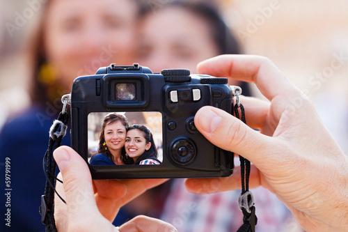 Fototapeta Taking a Photo of Women obraz na płótnie
