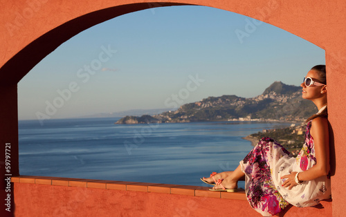 Keuken foto achterwand Landschap Happy brunette woman on vacation in Sicily