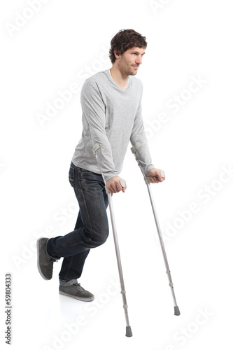 Foto Rehabilitation of an adult man walking with crutches