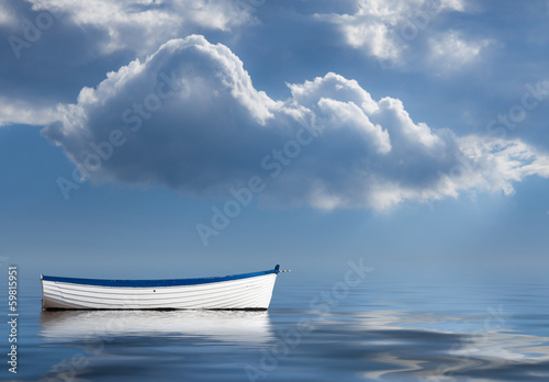 Old rowing boat marooned at sea Fototapet