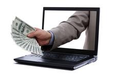 Dollar Bills Through A Laptop Screen