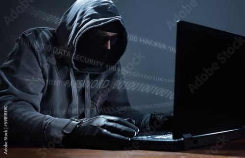 Fotografía  Hacker stealing data from a laptop