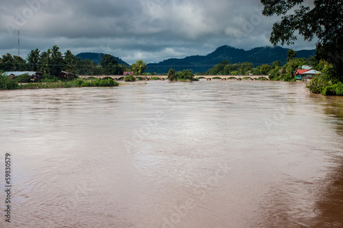 Fotografie, Obraz  Old bridge between islands on Mekong river, Laos