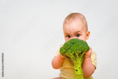 Photo  Baby eating broccoli