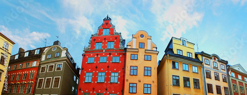 Photo  Red and Yellow iconic buildings on Stortorget in Stockholm