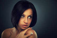 Close-up Portrait Of Beautiful Black Haired Young Woman