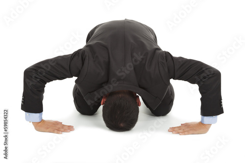 businessman apologize with japanese kneeling position Canvas Print