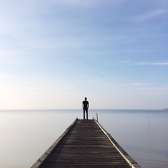 Fototapetapeople standing on jetty
