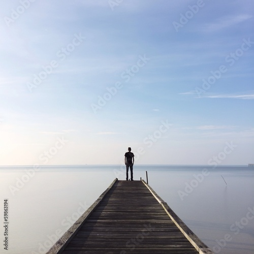 people standing on jetty - 59863194