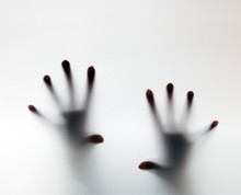 Hands Touching Frosted Glass. Conceptual Scream For Help