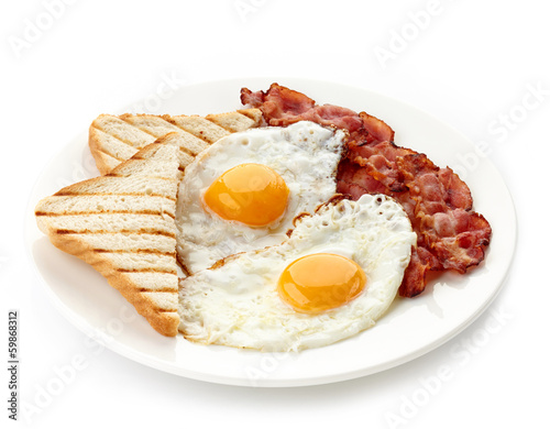 Foto auf Gartenposter Eier Breakfast with fried eggs, bacon and toasts