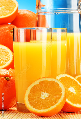 Fototapeta Composition with glasses of orange juice and fruits obraz na płótnie