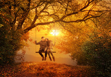 Romantic Couple Swing In The A...