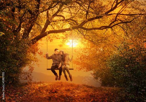 fototapeta na lodówkę Romantic couple swing in the autumn park