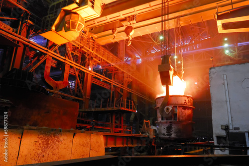 Fotografie, Obraz  steel works, crane with stove busket