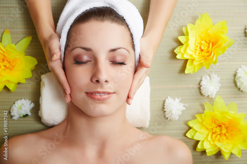 Fotografie, Obraz  Beautiful young woman lying relaxed in a spa salon