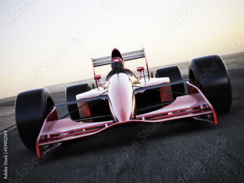 Fotografia  Race car racing on a track front view with motion blur