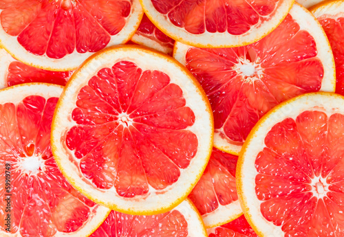 Texture of a ripe grapefruit slice