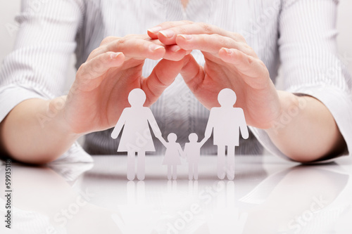 Fotografie, Obraz  Hands hug the family (concept)