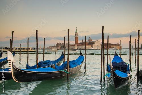 Venice with gondolas on Grand Canal against San Giorgio