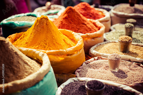 Indian colored spices at local market. Poster
