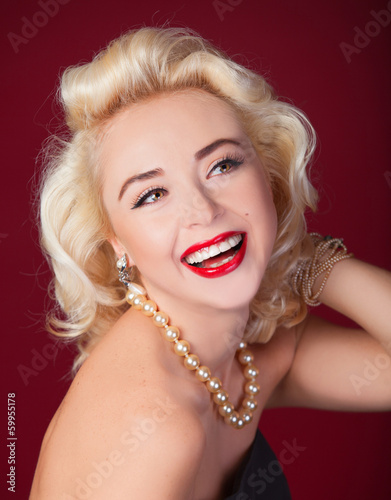 Photo  Pretty blond girl model like Marilyn Monroe