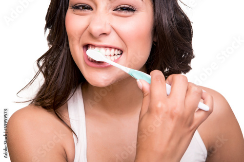 Woman holding a tooth brush Poster