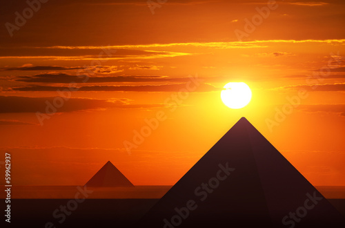 Ancient pyramids in sunset Canvas Print