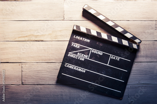 Photo  movie slate on a wooden background