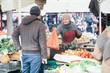 Man buying fresh vegetables at farmer's market