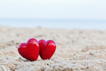 Two Red Hearts On The Beach Sy...