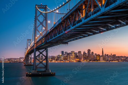 San Francisco skyline framed by the Bay Bridge at sunset Poster