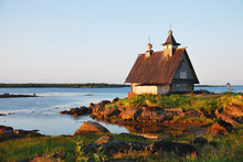 Old Wooden Church On Sunset Near White Sea, Russia North