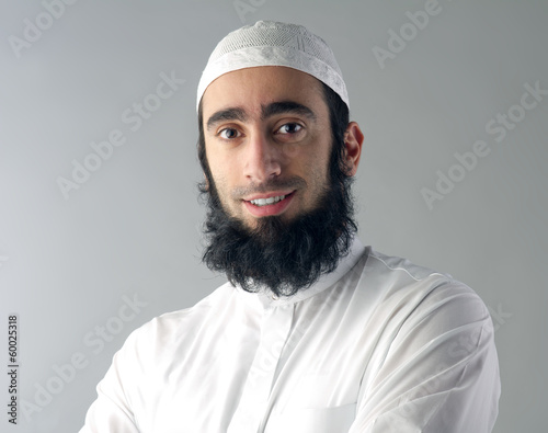 arabin muslim man with beard and traditional outfit