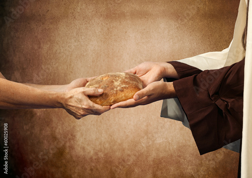 Jesus gives the bread to a beggar. Canvas Print