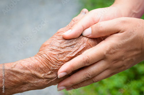 Fotografie, Obraz  Senior and young holding hands