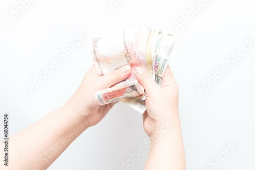 Fototapety, obrazy: Asian woman holding multiple bank notes