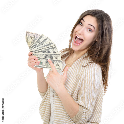 Fotografía  Cheerful attractive young lady holding cash and happy smiling ov