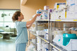 canvas print picture - Female Nurse Working In Storage Room