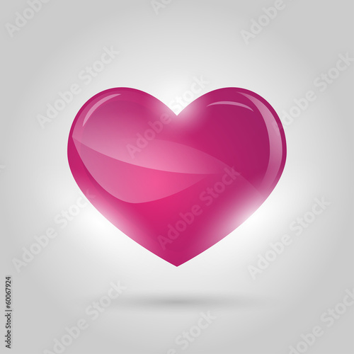glowing heart on gray background Canvas Print