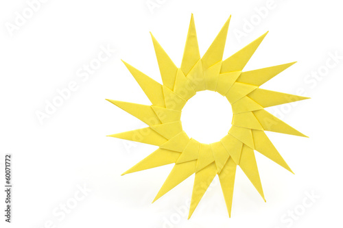 Origami  yellow paper sun isolated on white